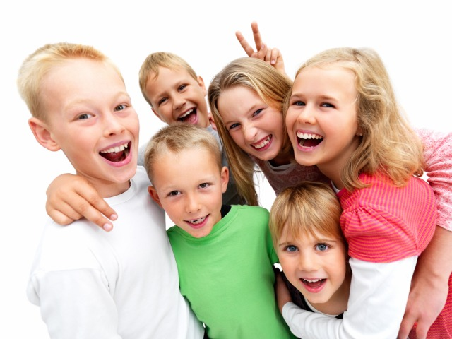 Closeup portrait of a young boys and girls smiling isolated on white background